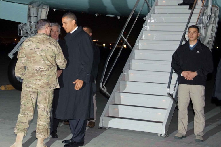 <p>US President Barack Obama is greeted by Lieutenant General Curtis Scaparrotti and US Ambassador to Afghanistan Ryan Crocker on May 1, 2012 upon arrival at Bagram Air Field, some 50km north of Kabul. Obama arrived in Afghanistan for a previously unannounced visit.</p>