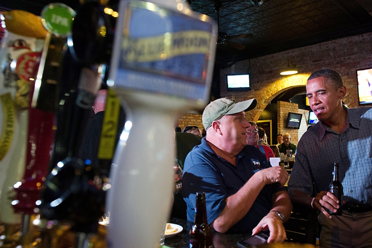 <p>US President Barack Obama talks with a patron at Ziggy's Pub and Restaurant in Amherst, Ohio, on July 5, 2012, during an unannounced visit while on a bus tour of Ohio and Pennslyvania.</p>