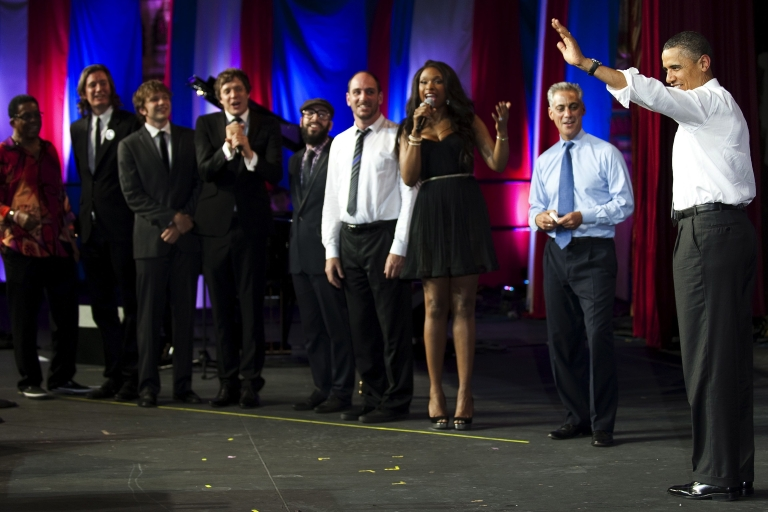 <p>President Barack Obama (R) walks on stage at the Aragon Ballroom in Chicago, Illinios, Aug. 3, 2011, as Herbie Hancock (L), members of the band OkGo (C), Jennifer Hudson (3rd R) and Chicago Mayor Rahm Emanuel (2nd R) sing