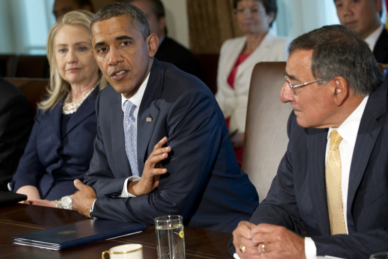 <p>US President Barack Obama speaks alongside Secretary of State Hillary Clinton (L) and Secretary of Defense Leon Panetta (R) as he holds a Cabinet meeting in the Cabinet Room of the White House in Washington, DC, July 26, 2012.</p>