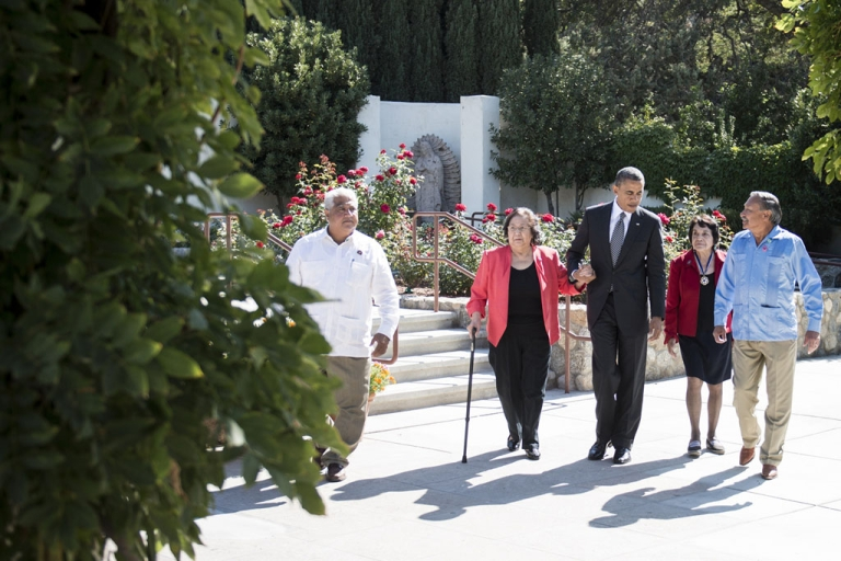 <p>(L-R) Paul F. Chavez, son of Cesar Chavez; Helen F. Chavez, widow of Cesar Chavez; President Barack Obama; Dolores Huerta, co-founder of the United Farm Workers; and Arturo S. Rodriguez, president of the United Farm Workers, walk to visit the grave of Cesar Chavez during a tour of a memorial garden at the Chavez National Monument Oct. 8, 2012 in Keene, California.</p>