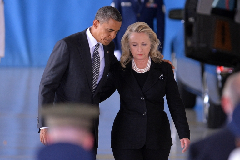 <p>US President Barack Obama and State Secretary Hillary Clinton return to their seats after speaking during the transfer of remains ceremony marking the return to the US of the remains of the four Americans killed in an attack this week in Benghazi, Libya, at the Andrews Air Force Base in Maryland on September 14, 2012.</p>