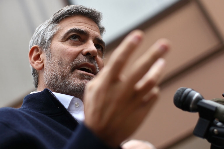 <p>For a minimum $3 donation, you can enter to win two tickets to actor George Clooney's house, where you could party with President Barack Obama.</p>