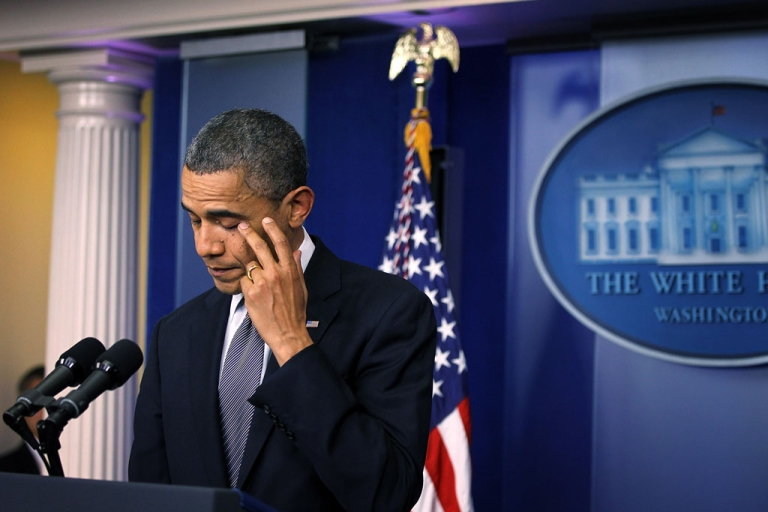 <p>U.S. President Barack Obama wipes tears as he makes a statement at the White House in Washington, DC, in response to the Sandy Hook elementary school shooting in Newtown, Connecticut, on December 14, 2012.</p>