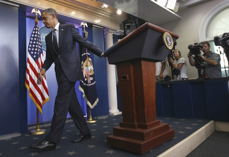 <p>U.S. President Obama walks away from the Brady Press Briefing Room following a brief statement on ongoing debt ceiling negotiations with congressional leaders July 19, 2011 in Washington, DC. Obama said a proposal offered by the bipartisan group, the 'Gang of Six', was 'a very significant step' on resolving the stalemate over the debt ceiling issue.</p>