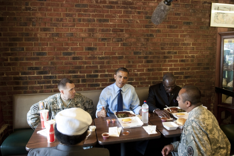 <p>US President Barack Obama has lunch with two soldiers and two local barbers in honor of Fathers Day weekend at Kenny's BBQ Smokehouse in Washington, DC, on June 13, 2012.</p>