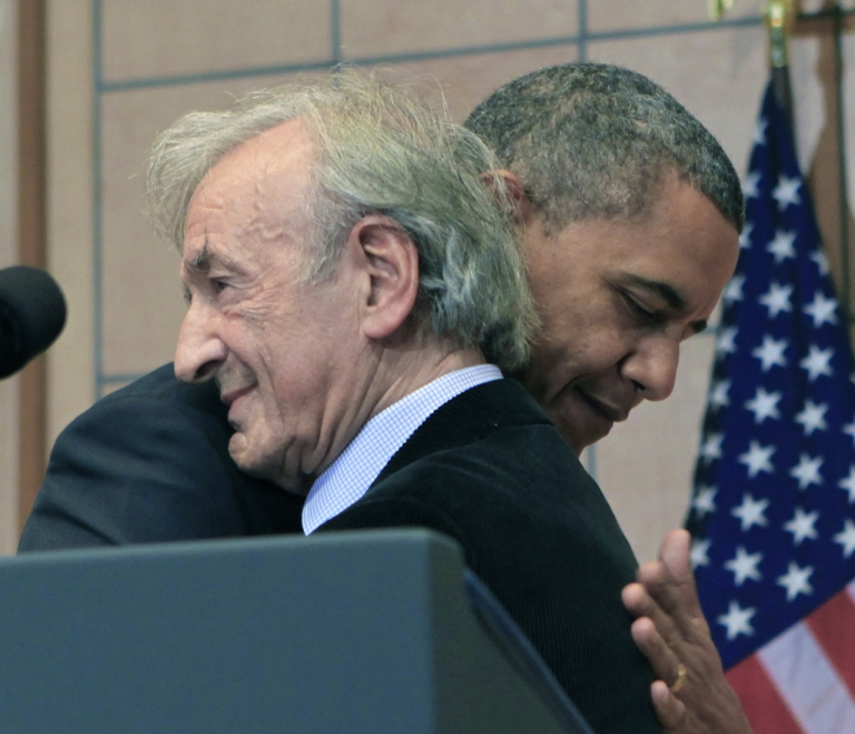 <p>President Barack Obama (R) hugs Elie Wiesel before a speech at the Holocaust Museum in the Hall of Remembrance at the Holocaust Museum April 23, 2012 in Washington, DC. Obama announced new sanctions against Iran and Syria for entities and people using technology to target citizens.</p>