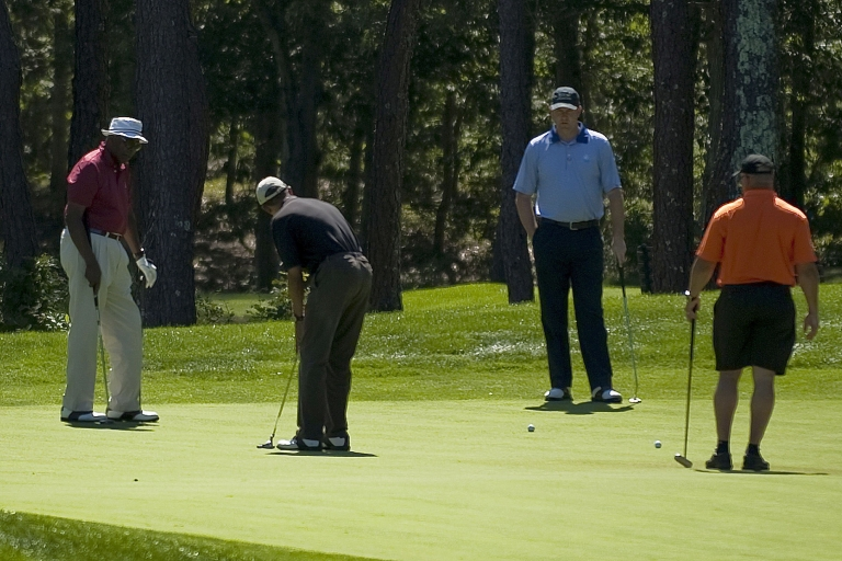 <p>US President Barack Obama (2nd L) putts on the first green at Farm Neck Golf Course in Oak Bluffs, Massachusetts, August 23, 2011, with Vernon Jordan (L), White House Trip Director Marvin Nicholson (2nd R) and Eric Whitaker (R).</p>