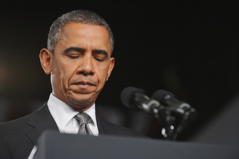 <p>US President Barack Obama pauses as he speaks on the shootings in Aurora, Colorado at what was scheduled originally as a campaign event at Harborside Event Center July 20, 2012 in Fort Myers, Florida.