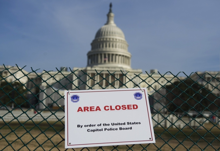 <p>An area around the US Capitol is closed off as workers prepare for the US Presidential Inauguration ceremony in Washington, DC, on January 8, 2013. US President Barack Obama will be ceremonially sworn in for his second term during the public Inauguration event attended by hundreds of thousands of spectators on January 21, 2013.</p>