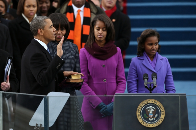 <p>US President Barack Obama is sworn in during the public ceremony as First lady Michelle Obama, and daughters, Sasha Obama (R) and Malia Obama look on during the presidential inauguration on the West Front of the U.S. Capitol January 21, 2013 in Washington, DC. Barack Obama was re-elected for a second term as President of the United States.</p>
