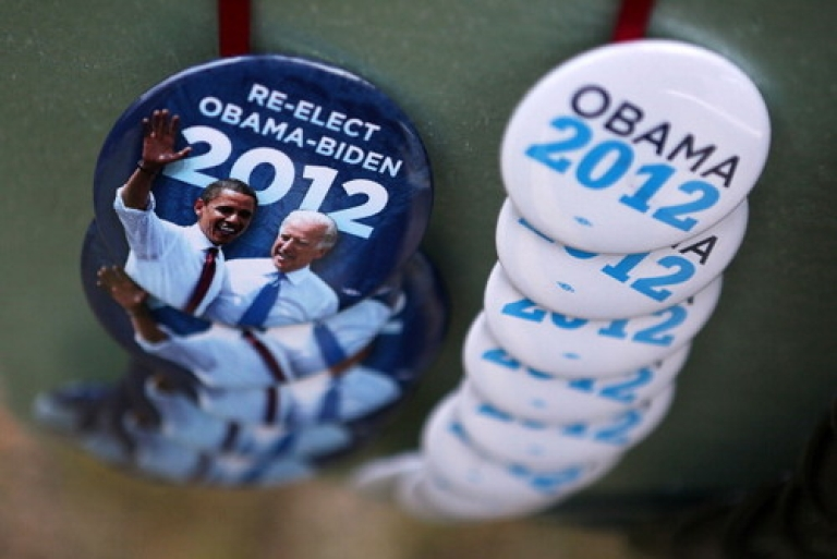 <p>Campaign buttons are sold outside U.S. President Barack Obama's ''A Vision for Virginia's Middle Class'' campaign event July 14, 2012 at Walkerton Tavern in Glen Allen, Virginia. On Sunday, Obama made an uncharacteristic call for India to open its markets to US companies -- garnering mixed reviews here in New Delhi.</p>