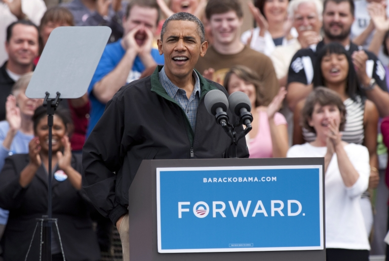 <p>President Barack Obama greets the crowd during a grassroots campaign stop at Bayliss Park, August 13, 2012, in Council Bluffs, Iowa. The shrinking American middle class thinks Congress and Obama are to blame for the decline in their quality of life.</p>