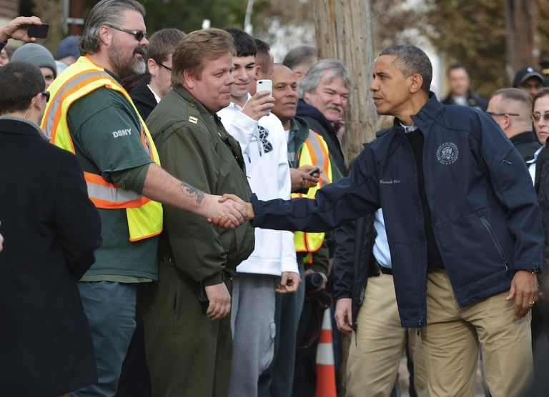<p>US President Barack Obama greets workers as he visits Cedar Grove Avenue on Staten Island to visit areas stricken by Hurricane Sandy in New York City on November 15, 2012.</p>