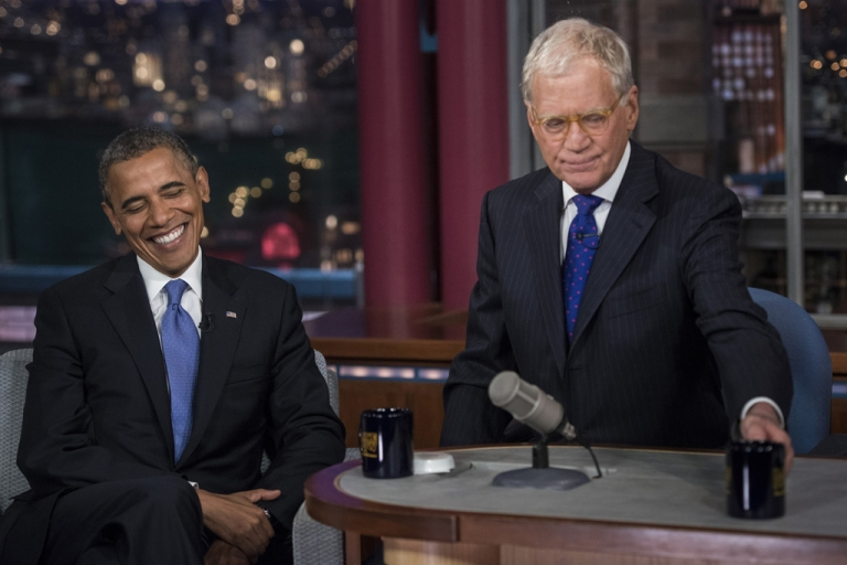 <p>US President Barack Obama and David Letterman speak during a break in the taping of the