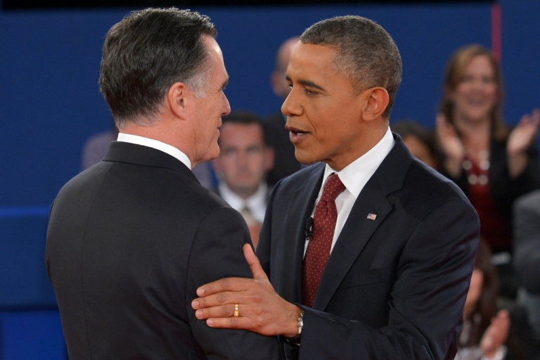 <p>US President Barack Obama(R) greets Republican presidential candidate Mitt Romney October 16, 2012 as the candidates arrive on stage for the second presidential debate at the David Mack Center at Hofstra University in Hempstead, New York.</p>