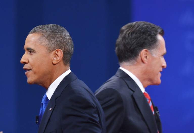 <p>US President Barack Obama Republican presidential candidate Mitt Romney make their way to greet their wives at the end of the third and final presidential debate October 22, 2012 at Lynn University in Boca Raton, Florida.</p>