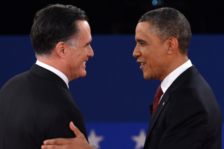 <p>US President Barack Obama and Republican presidential candidate Mitt Romney arrive on stage for the second presidential debate, the only held in a town hall format, at the David Mack Center at Hofstra University in Hempstead, New York, October 16, 2012, moderated by CNN's Candy Crowley.</p>