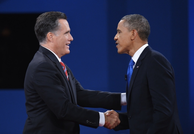 <p>US President Barack Obama shakes hands with Republican presidential candidate Mitt Romney at the end of the third and final presidential debate October 22, 2012 at Lynn University in Boca Raton, Florida.</p>