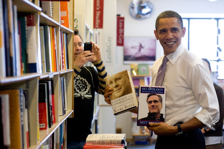 <p>President Barack Obama holds up copies of Karl Rove's book and Mitt Romney's book. A new poll shows Obama and Romney are neck-in-neck.</p>