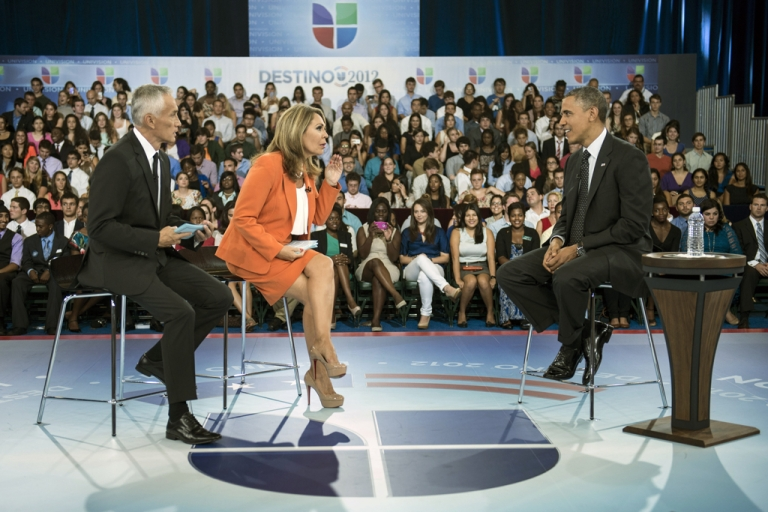 <p>Co-hosts Jorge Ramos, left, and Maria Elena Salinas sit with US President Barack Obama during a break in a taping of Univision News'