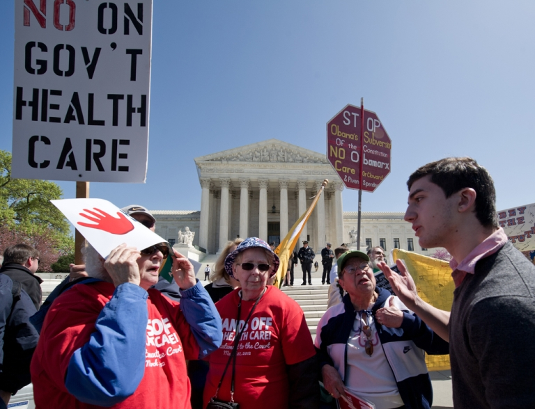<p>A supporter of President Barack Obama's health care reforms  argues with several elderly women who are against the reforms in front of the US Supreme Court in Washington, DC after the morning session March 27, 2012. The US Supreme Court Tuesday took up the most contentious part of President Barack Obama's landmark health care reform, hearing arguments on whether it is constitutional to require Americans to buy insurance coverage. The second day of an unprecedented three days of arguments into the Affordable Care Act, derided by opponents as