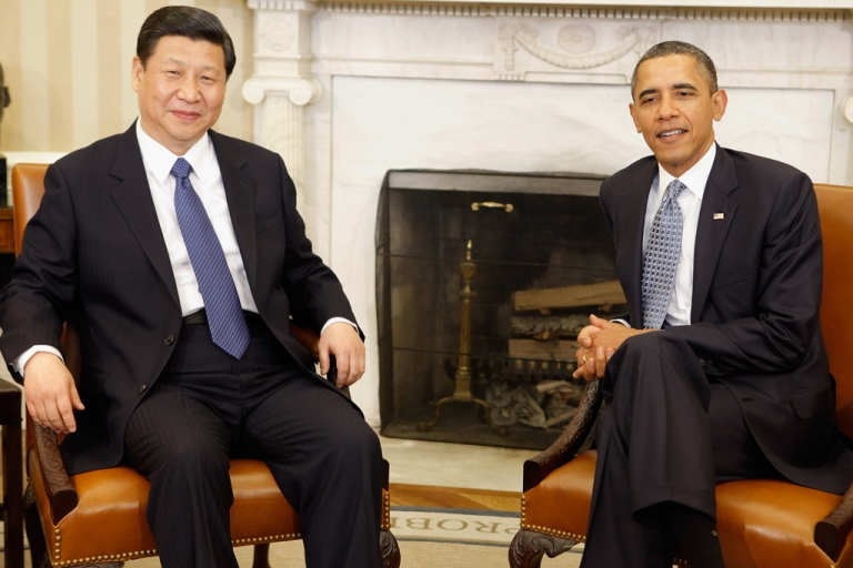 <p>WASHINGTON, DC - FEBRUARY 14:  U.S. President Barack Obama (R) and Chinese Vice President Xi Jinping pose for photographs before meeting in the Oval Office at the White House February 14, 2012 in Washington, DC. While in Washington, Vice President Xi will meet with Obama, Vice President Joe Biden and other senior Administration officials to discuss a broad range of bilateral, regional, and global issues.  (Photo by Chip Somodevilla/Getty Images)</p>