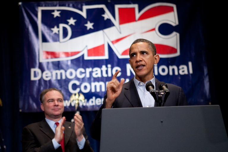 <p>President Barack Obama receives applause from Democratic National Committee chairman Tim Kaine (L) as he delivers remarks at the DNC winter meeting on Feb. 6, 2010, in Washington, DC.</p>
