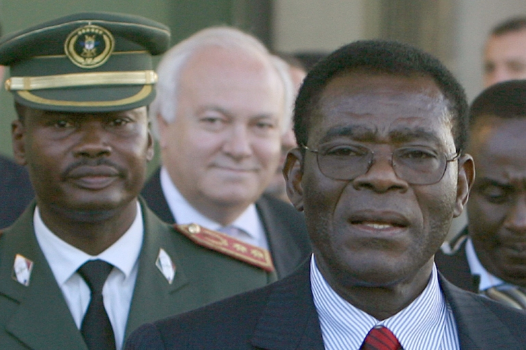 <p>Teodorin Obiang's father, Equatorial Guinea President Teodoro Obiang, at right, is welcomed by Spanish Foreign Minister Miguel Angel Moratinos, center, on arrival in Madrid in November, 2006.</p>