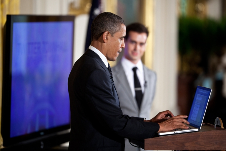 <p>U.S. President Barack Obama posts a Tweet during an online Twitter town hall meeting from the East Room of the White House.</p>