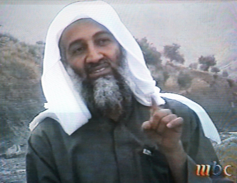 <p>This frame grab from the Saudi-owned television network MBC (Middle East Broadcasting Center) shows alleged terror mastermind Osama bin Laden gesturing an undated videotape broadcast by the Dubai-based MBC 17 April 2002.</p>