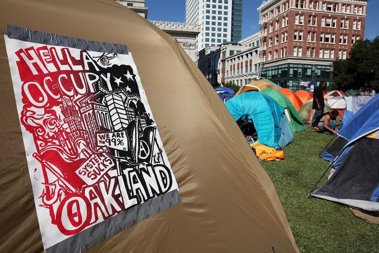 <p>This sign was posted on the side of a tent at the Occupy Oakland protest outside of Oakland City Hall on October 13. More than 200 police officers ousted the protesters of the Occupy Oakland movement early Tuesday morning.</p>