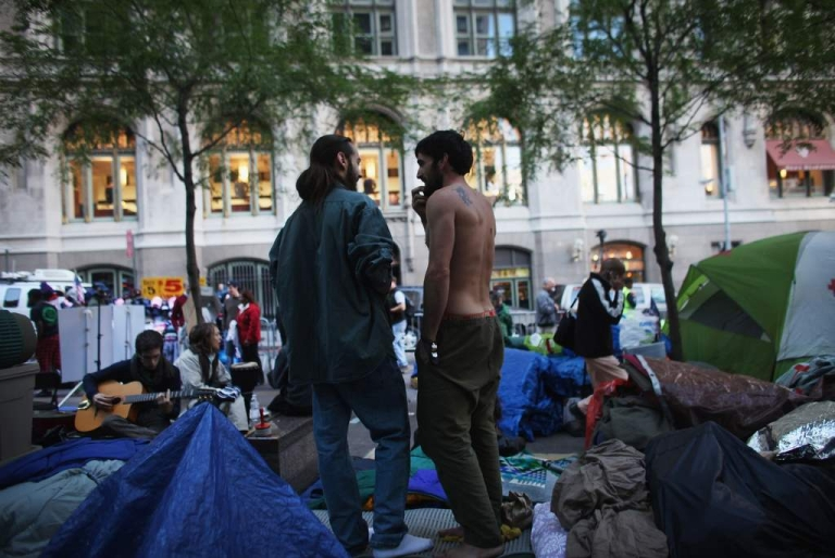 <p>Men stand in Zuccotti Park in the Financial District where 'Occupy Wall Street' protesters are living on October 17, 2011 in New York City.</p>