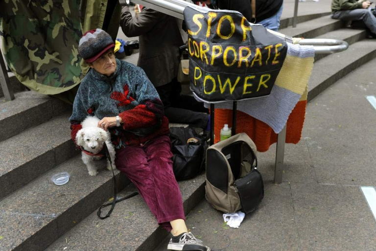 <p>Demonstrators with 'Occupy Wall Street' continue their protest at Zuccotti Park in New York on October 20, 2011.</p>
