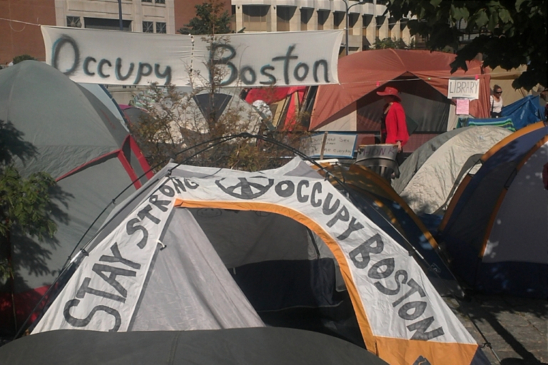<p>A banner hangs above Occupy Boston's camp in Dewey Square, located in Boston's financial district.</p>