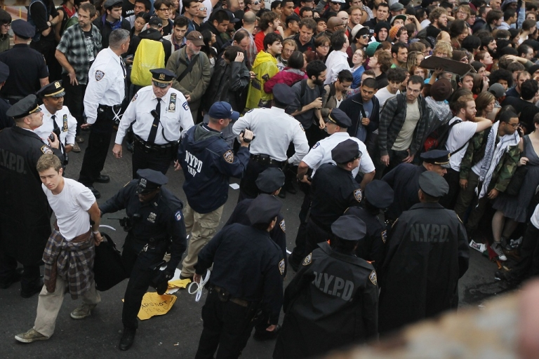 <p>Police arrest a demonstrator affiliated with the Occupy Wall Street movement after he and fellow protesters attempted to cross the Brooklyn Bridge on Oct 1, 2011 in New York City.</p>