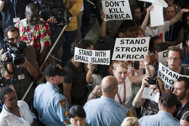 <p>Protesters gather in a hall inside the Durban, South Africa conference center where the final day of UN climate change negotiations, known as COP 17, are being held, on December 9, 2011.</p>
