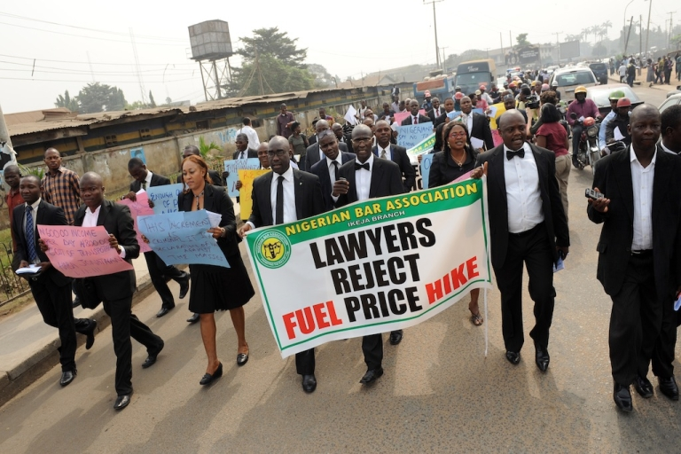 <p>Occupy Nigeria has arrived in Ibadan. Here, lawyers carry a banner and placards as they march in Lagos streets to protest against soaring fuel prices on January 5, 2012. Nigeria has seen increasingly volatile demonstrations since the government announced the end of fuel subsidies, causing petrol prices to instantly double.</p>