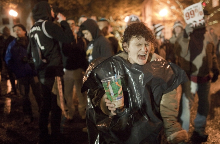 <p>A woman drinks and dances at the Occupy Portland movement, November 13, 2011 in Portland, Oregon. In spite of an eviction notice for early Sunday morning, Portland police delayed closing two downtown parks early today as thousands of people converged to support the Occupy Portland movement.</p>