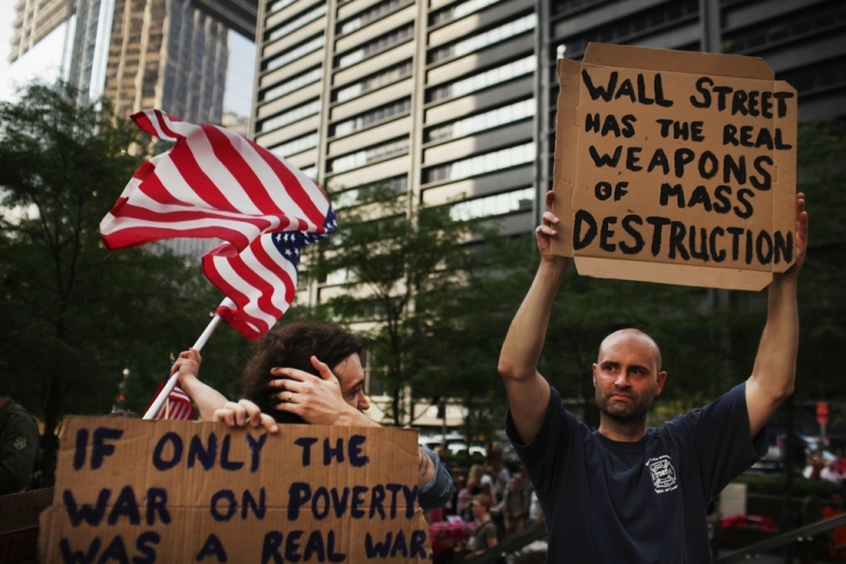 <p>Demonstrators opposed to corporate profits on Wall Street march in the Financial District on September 26, 2011 in New York City.</p>