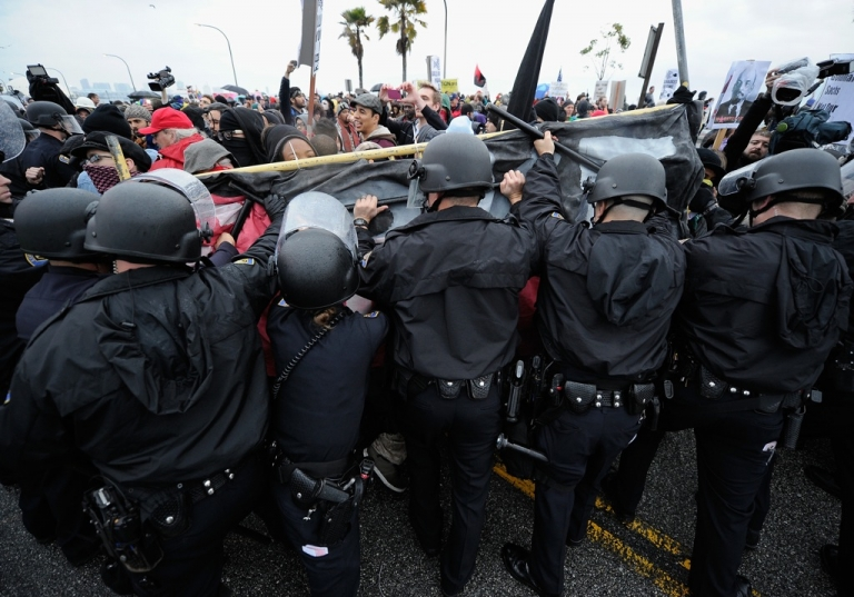<p>Protestors stand off with police after blocking the road leading to SSA Marine, a shipping company that is partially owned by investment bank Goldman Sachs at the Port of Long Beach on December 12, 2011 in Long Beach, California. Following a general strike coordinated by Occupy Oakland that closed the Oakland port on November 2 hundreds are expected to try and shut down all West Coast ports as Occupy movements in Los Angeles, San Diego, Oakland, Portland, Seattle and Tacoma have joined the demonstration.</p>