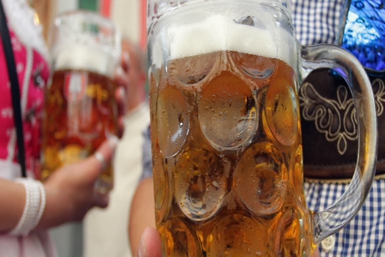 <p>Mugs of beer, like these served at the Oktoberfest beer festival in Munich, Germany, this year, are a new feature of Oktoberfest in Cullman, Alabama.</p>