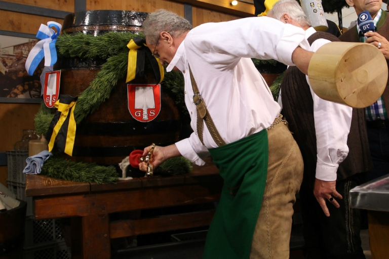 <p>Munich mayor Christian Ude taps the first barrel of beer with the traditional 'O'zapft is!' (It's tapped!) to start the Oktoberfest 2012 beer festival at Theresienwieseat on September 22, 2012 in Munich, Germany.</p>