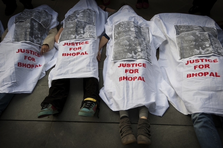 <p>Protesters against Dow Chemical's Olympic sponsorship demonstrate outside the venue of the final IOC press conference in central London on March 30, 2012. Dow has been linked to the 1984 Bhopal Gas disaster.</p>