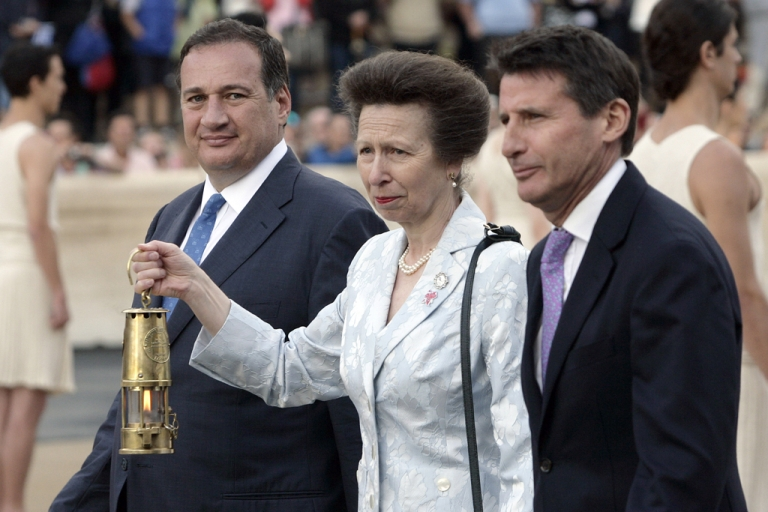 <p>Princess Anne, Princess Royal (C) holds a carrier containing the Olympic flame (C) alongside Spiros Kapralos (L),  President of Greek IOC, at the Panathinaiko stadium during the Olympic Torch Handover Ceremony, on May 17, 2012 in Athens, Greece.</p>