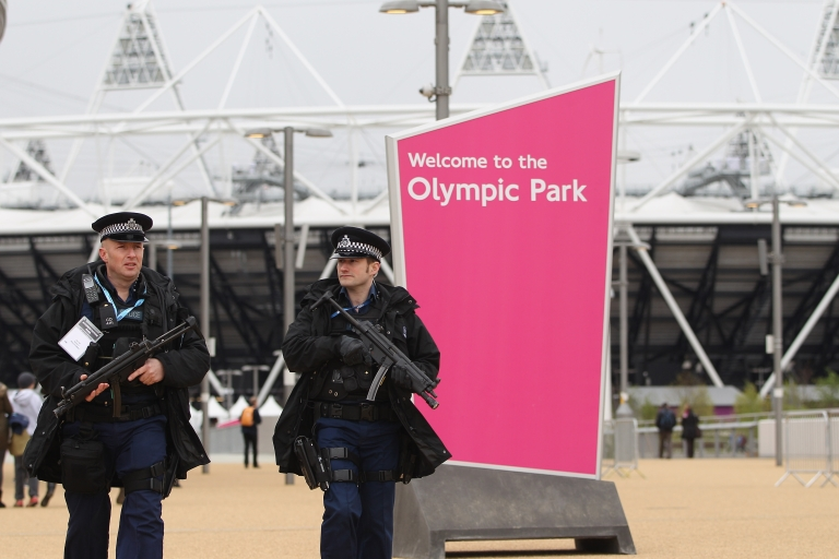 <p>Armed police officers patrol the Olympic Park</p>