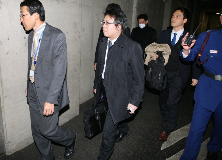 <p>Investigators raid Olympus' Tokyo headquarters on December 21, 2011 as part of an investigation into a $1.7 billion fraud at the Japanese camera company.</p>