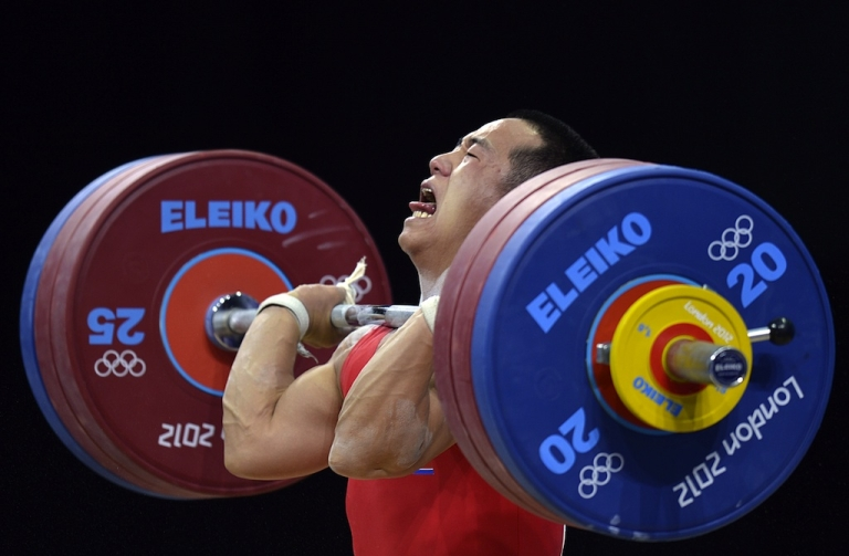 <p>North Korean weightlifter Om Yun Choi in action at the London Olympics.</p>