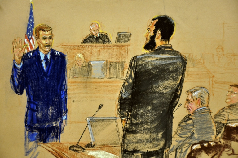 <p>In this Pentagon-approved photograph of a sketch by Janet Hamlin, Omar Khadr addresses USAF Capt. Michael Grant on Oct. 25, 2010, in Guantanamo Bay, Cuba. Khadr filed a request on April 18, 2012, to serve his sentence in a Canadian jail.</p>