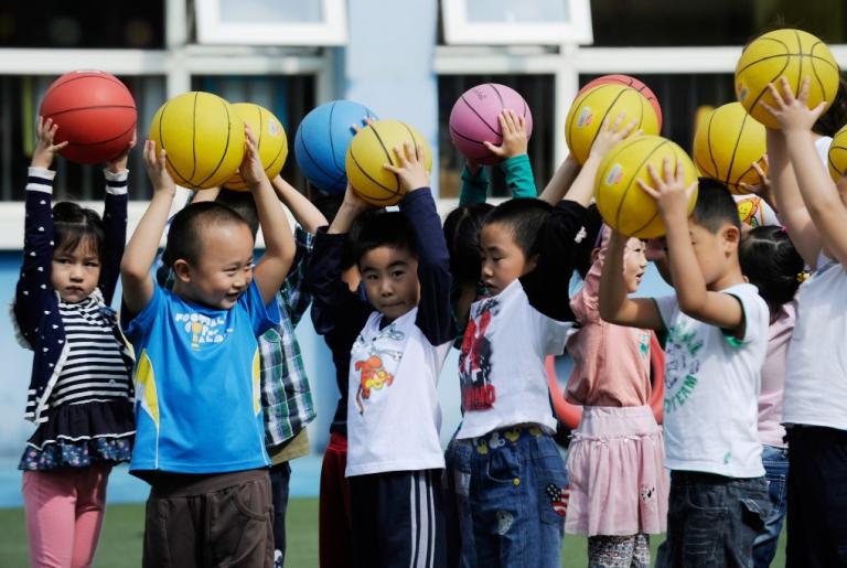 <p>Children playing at a kindergarten in Beijing.</p>
